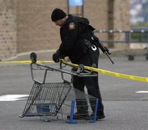 State Trooper sets up a police line using a shopping cart following reports of shots fired near a Wal-Mart store in Wilkes-Barre, Pa., Saturday, Oct. 17, 2015. (Dave Scherbenco/The Citizens' Voice via AP)