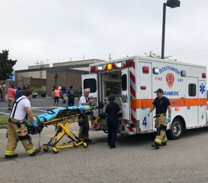 Medical staff stage outside a Walmart store, Tuesday, July 30, 2019, in Southaven, Miss. (AP Photo/Adrian Sainz)