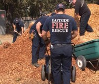 Wash. firefighters work at farm for abused kids on day off from battling wildfires