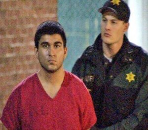 This late Saturday, Sept. 24, 2016, image from video by KIRO7 photographer Jeff Ritter shows suspected Cascade Mall shooter Arcan Cetin at Skagit County Jail in Mount Vernon, Wash., after his arrest in Oak Harbor, Wash., earlier in the evening. (Jeff Ritter/KIRO7.com via AP)