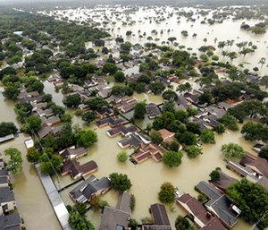 Water from Addicks Reservoir flows into neighborhoods as floodwaters from Tropical Storm Harvey rise in Houston. (AP Photo/David J. Phillip)