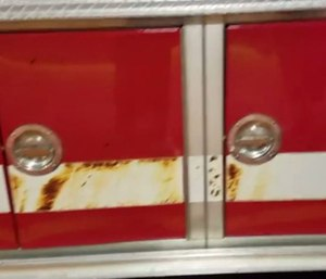 Blistered paint can be seen on the fire truck, which also had melted tires and pump panel damage.