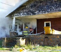 Fire chief blown through window at fatal house fire