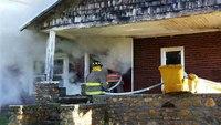 Fire chief blown through window at fatal house fire