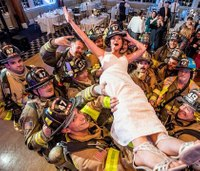 Photo: Firefighters pose with bride after evacuating wedding reception