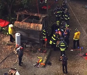 A crew of first responders are shown saving Ernest Silva from a 100-year-old well. (Photo/YouTube)