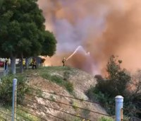 Thousands evacuate after wildfire threatens Calif. homes