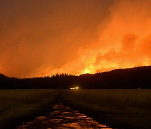 A group of paramedics are working to keep firefighters safe with their new approach of keeping close to them while they battle wildfires. (Photo/AP)