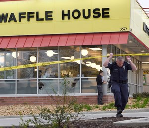 Law enforcement officials work the scene of a fatal shooting at a Waffle House. (Photo/AP)