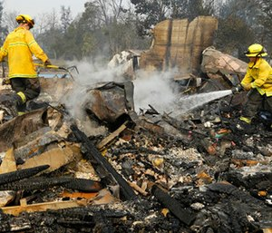 Firefighters douse hot spots in the Coffey Park area of Santa Rosa, Calif. (AP Photo/Ben Margot)