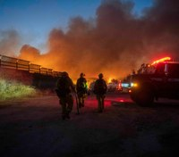 Southern Calif. wildfire caused by suspects' car in police pursuit