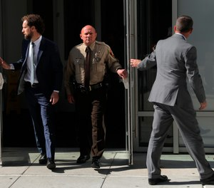 St. Louis County police Sgt. Keith Wildhaber, center, alleges he has been repeatedly passed over for promotions because of his sexual orientation. (Photo/AP)
