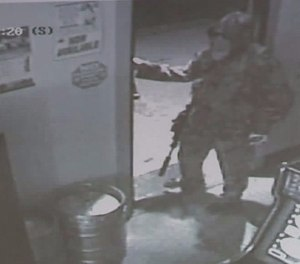 This dude was loaded for bear, staged an almost meaningless armed robbery and was almost certainly headed for his car/cover to prepare for the arrival of the cavalry. (Photo/Sheboygan Police Department)