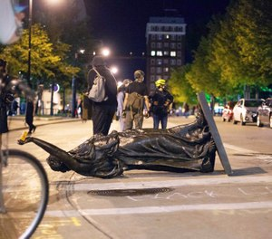 Demonstrators toppled a statue in Madison, Wisconsin June 23 after a night of violent protests. (Photo/Emily Hamer/Wisconsin State Journal via AP)