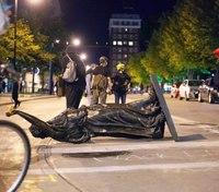 Crowds tear down statues, attack Wis. state senator