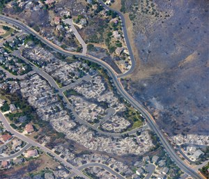 This aerial photo shows burned homes in the Mountain Shadows residential area of Colorado Springs, Colo., that were destroyed by the Waldo Canyon wildfire.
