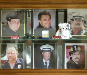 In this 2001 file photo, a display case in the lobby of the Worcester Fire Department Grove Street station memorializes six firefighters who were killed at the cold storage warehouse fire Dec. 3, 1999, in Worcester, Mass. (AP Photo/Charles Krupa, File)