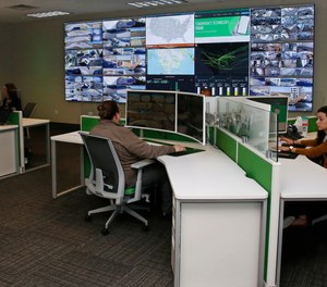 Paycom personnel monitor physical and IT security in the command center at the Oklahoma City Paycom campus Monday, Nov. 25, 2019, in Oklahoma City.