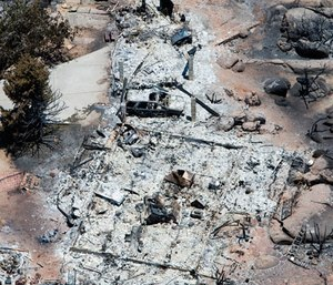 This aerial photo shows Yarnell, Ariz. on Wednesday, July 3, 2013, in the aftermath of the Yarnell Hill Fire that claimed the lives of 19 members of an elite firefighting crew. (AP Photo/Tom Tingle)