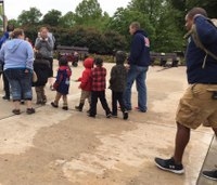Photos: Firefighters take students with hearing impairments to zoo
