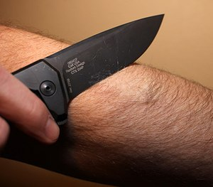 Knife aficionados often test the sharpness of a blade, such as the ZT 0804CF shown here, by shaving a bit of hair off their support-side forearm. (Photo/Sean Curtis)