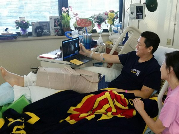 An and his wife viewing via Skype the special presentation to Dallas Police Department officers.