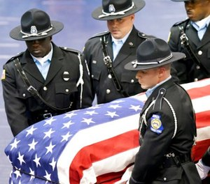 Members of the Georgia Department of Corrections carry the body of corrections officer Sgt. Curtis Billue out of the Wilkinson County High School gymnasium after funeral services Saturday, June 17, 2017 in McIntyre, Ga. (Jason Vorhees/The Macon Telegraph via AP)