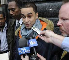 In this Dec. 9, 2008 file photo Michael Mineo, who says he was sodomized on Oct. 15, 2008 with a baton by a police officer in a Brooklyn subway station, speaks to the media outside Brooklyn state supreme court in New York.