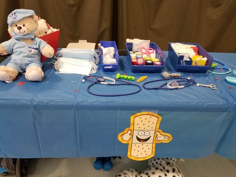 The event included three first aid tables where children practiced procedures on teddy bears. (Photo/NS Ambulance)
