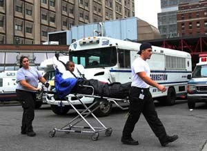 AP Photo A patient is seen being evacuated from Bellevue Hospital in New York on Oct. 31. About 500 patients were evacuated in total due to storm damage.