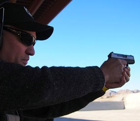 PoliceOne columnist Lindsey Bertomen tries out the new Sig Sauer P290RS at Media Day at the range to kick off SHOT Show 2014.