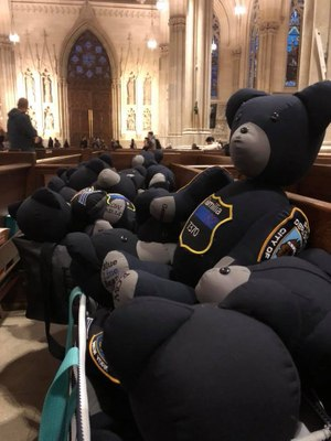 In this photo, bears line a pew at St. Patrick Cathedral in New York City. The family traveled to the city to deliver bears to the NYPD. (Photo/Blue Line Bears)
