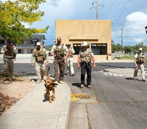 A team from Winslow's Department of Corrections works through scenario training in Williams, Arizona. (Photo/Loretta Yerian, Williams-Grand Canyon News)