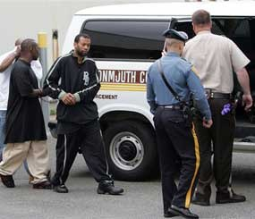Lorenzo White, facing camera, and two other members of the Bloods street gang set are escorted into a Monmouth County, N.J. Sheriff's van to be transported to Monmouth County Jail in Freehold from State Police Troop B Headquarters in Totowa, N.J. (AP Photo)