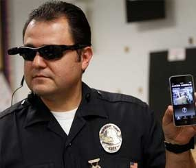 Los Angeles Police Sgt. Daniel Gomez demonstrating a video feed from his camera into his cellphone as on-body cameras are demonstrated for the media in Los Angeles. ( AP Images)