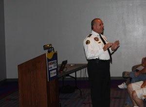 Image Drew JohnsonKen Bouvier speaks about EMS strategies for handling mass shootings at the 2011 EMS Expo in Las Vegas.