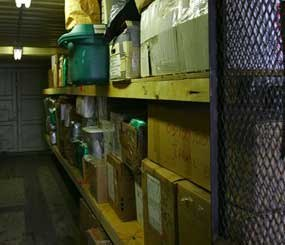 Boxes containing evidence sit in a storage facility at a police station.