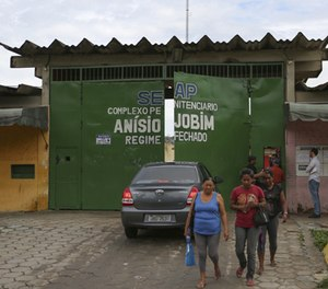 Relatives of prisoners wait to know the names of inmates who died in a prison riot, outside Anisio Jobim Penitentiary Complex in Manaus, Brazil, Tuesday, Jan. 3, 2017.