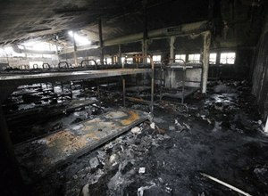 In this Tuesday Aug. 11, 2009 file photo, dozens of burned-out bunks are seen in a dormitory damaged by fire, during a tour of the California Institution for Men in Chino, Calif.