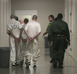Inmates are moved through the administrative segregation unit at California State Prison, Sacramento, in Folsom, Calif., Friday, March 30, 2007. (AP photo)