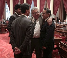 Assemblyman Gil Cedillo, D-Los Angeles, right, is congratulated by Senators Ron Calderon, D-Monterey Park, second from right, Mark Leno, D-San Francisco, third from right, and Kevin de Leon, D-Los Angeles, left, after the Senate approved his measure to allow illegal immigrants in California to get state drivers licenses, at the Capitol in Sacramento, Calif., Wednesday, Aug. 29 2012. (AP Photo/Rich Pedroncelli)