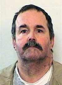 Convicted killer Charles Smith,one of three inmates who escaped from the Indiana State Prison Sunday night, who was caught Monday near the vacation home of Chicago Mayor Richard Daley by one of his bodyguards. (AP photo)