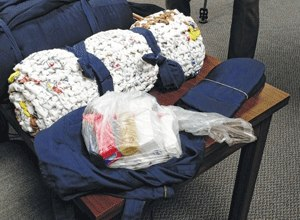 The Lima News Inmates at Allen Correctional Institution created care packages for homeless people, with the bags and sleeping bags made from scrap prison uniform material. The mats were made by weaving plastic shopping bags together. (Photo Craig Kelly/Limaohio.com)