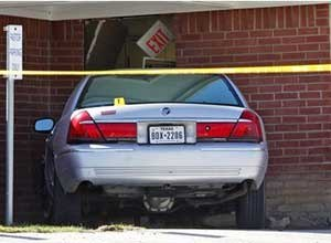 AP Photo/LM Otero Forest Hill Police Chief Dan Dennis says the pastor of the church is dead after the driver of the car crashed into the building and began to assault him.