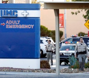Las Vegas police work on the scene of an officer-involved shooting at University Medical Center on Monday, Sept. 25, 2017, in Las Vegas.