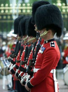 AP Photo/Max NashColdstream Guards stand at attention at Buckingham Palace on Sept. 13, 2001, during a special Changing of the Guard, ordered by Queen Elizabeth II in honor of the victims of the 9/11 terrorist attacks.
