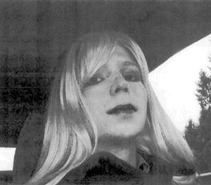In this undated file photo provided by the U.S. Army, Pfc. Chelsea Manning poses for a photo wearing a wig and lipstick. (U.S. Army via AP, File)