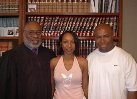 This photo shows Maurice Clemmons, right, his wife Nicole Smith, center and Judge Marion Humphrey after the couple was married in the summer of 2004. (AP photo/Pulaski County Circuit Court)