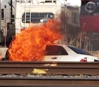 Probation officer rescues woman from flaming car