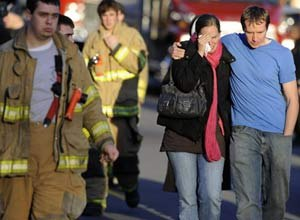 AP PhotoFirefighters and families gather at a staging area following the shooting.